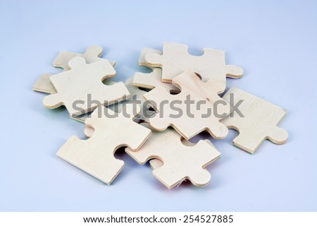 Stack of wooden puzzle. Puzzle made of wood. - stock photo