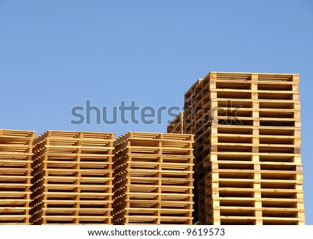 Stack of wooden shipping pallets in warehouse