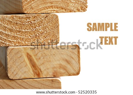 Stack of wooden 2X4s on white background with copy space. - stock photo