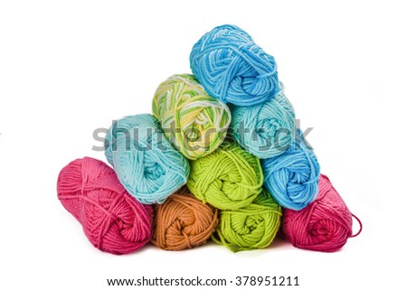 Stack of yarn on a white background. - stock photo