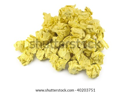 stack of yellow crumpled paper balls on white background - stock photo