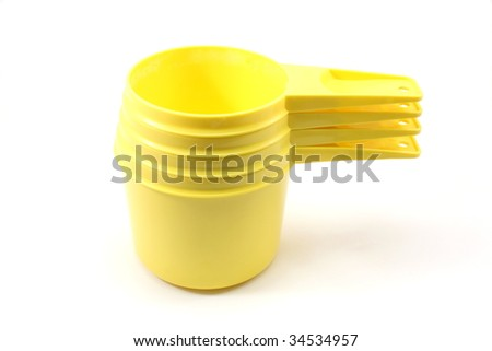 Stack of 4 yellow plastic measuring cups