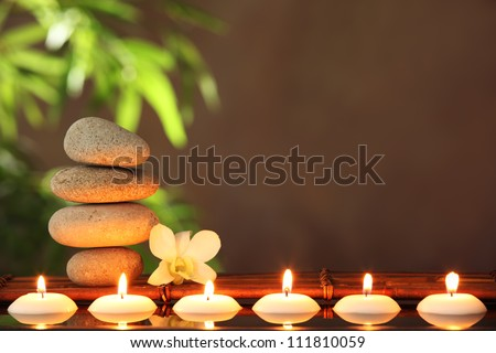 Stack of zen stones and aromatic candles on table,Zen concept. - stock photo