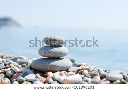 stack of zen stones near sea - stock photo