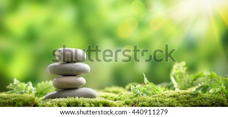 Stack of zen stones on nature background - stock photo