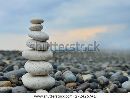 stack of zen white stones on beach - stock photo