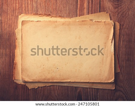 Stack old papers on a wooden table - stock photo