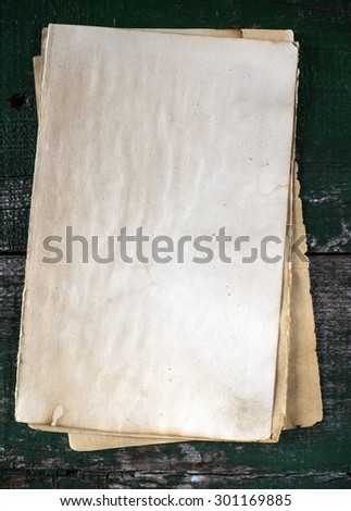 Stack old papers on a wooden table