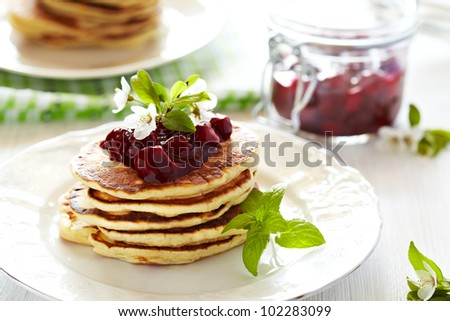 Stack pancakes with cherry sauce - stock photo
