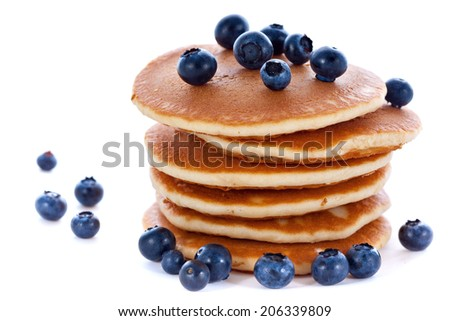 Stack pile of fresh pancakes with blueberries for breakfast on white background - stock photo