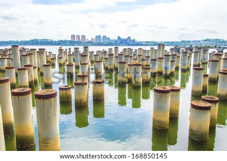 Stack piles for building foundation - stock photo