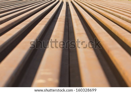Stack rusty railway background - stock photo
