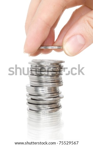 stack silver coins with reflection and hand with coin isolated on white - stock photo