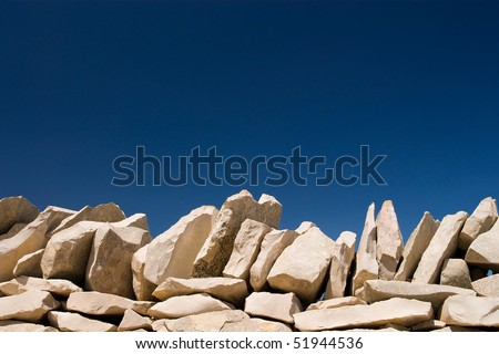 stack stone on blue sky background - stock photo