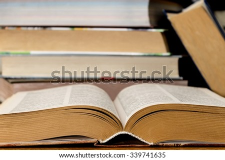 stack thick books on the table