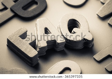 Stack wood letters of FAQ abbreviation ( frequently asked questions ) - stock photo