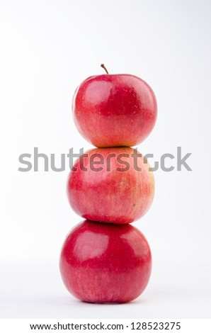 Stacked apples isolated on white