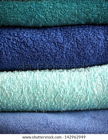 stacked bath towels - blue and turquoise - stock photo