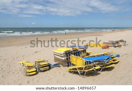 Stacked beach chairs on the beach