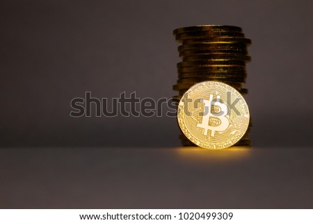 Stacked Bitcoins on dark background