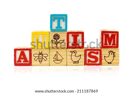 Stacked blocks spelling autism on white background  - stock photo