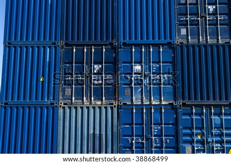 Stacked blue cargo containers - stock photo