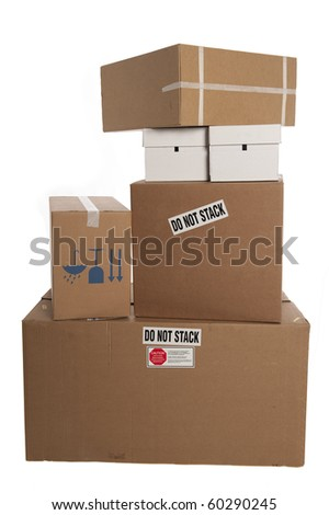 """Stacked boxes with stickers saying """"do not stack"""" - stock photo"""