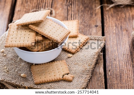 Stacked Butter Biscuits (close-up shot) on wooden background - stock photo