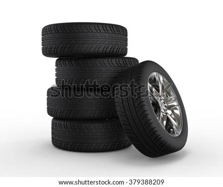 Stacked car wheels and tires - stock photo