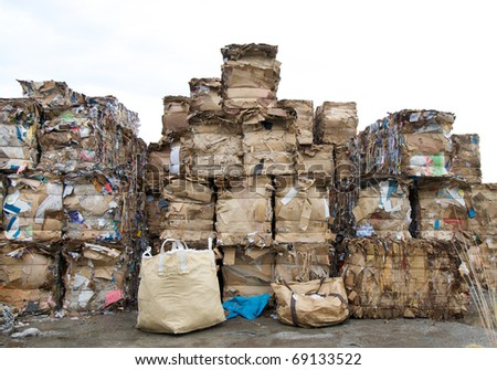 stacked cardboard and paper ready for recycling - stock photo