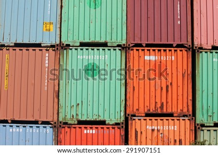 Stacked Cargo Containers at a Railroad Track - stock photo