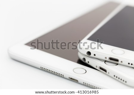stacked cell phone and tablet - stock photo