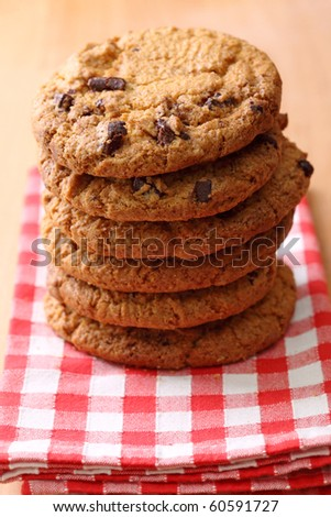 Stacked chocolate cookies on table,close up - stock photo
