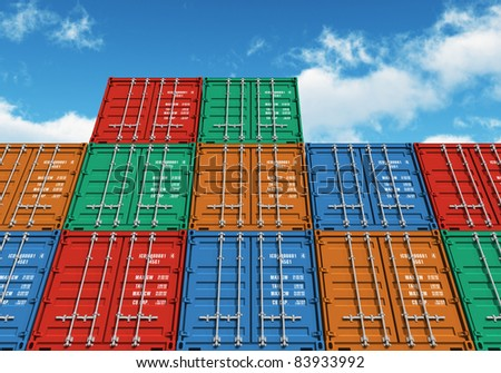 Stacked color cargo containers over the blue sky with clouds - stock photo