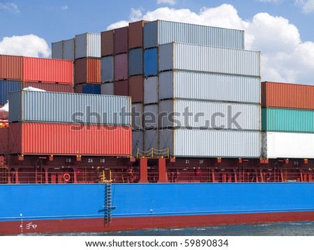 Stacked colorful containers on a ship deck