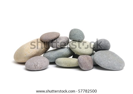 Stacked colorful sea stones on white background - stock photo