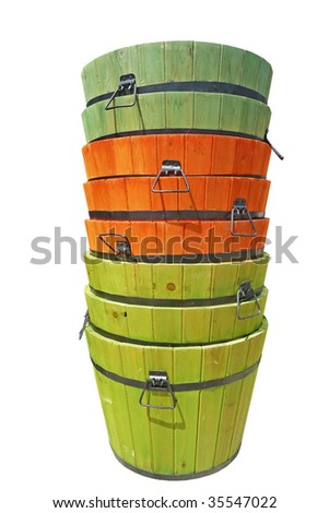 Stacked colorful stained wooden buckets isolated on white