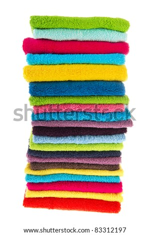 Stacked colorful towels isolated over white background