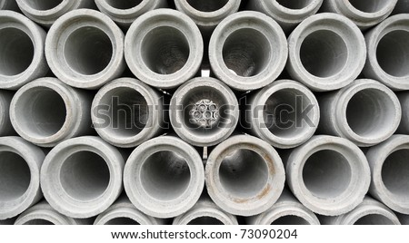 Stacked concrete drainage pipes abstract - stock photo