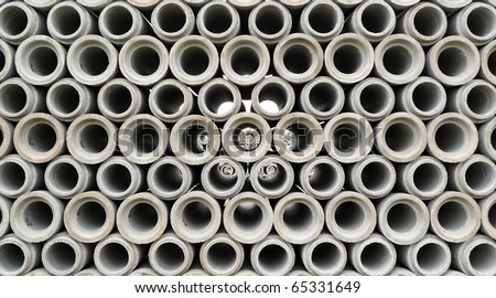 Stacked concrete pipes abstract - stock photo