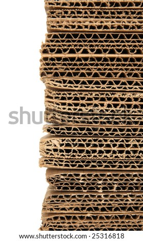 Stacked corrugated cardboard closeup, isolated on white. - stock photo