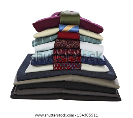 Stacked dress shirts with tie and pants isolated on white background - stock photo