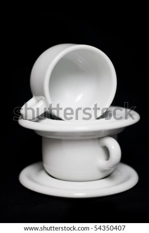 Stacked espresso coffee cups on isolated on black background