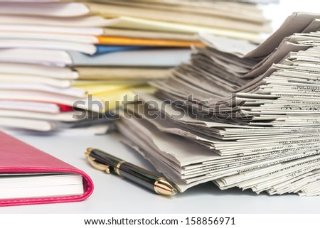 Stacked files and notebook of red color. - stock photo
