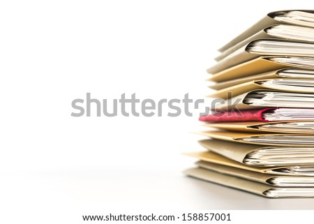 Stacked files.On white background. - stock photo