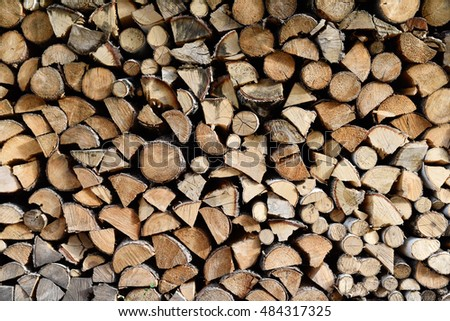 Stacked firewood for cold season close up - background
