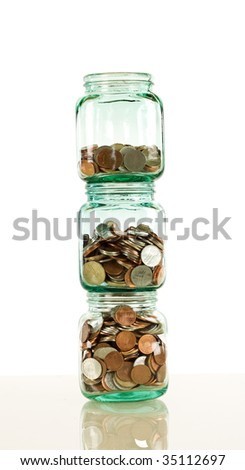 Stacked glass jars with coins - savings and financial concept, vertical banner format - stock photo