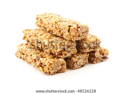 Stacked Granola Bars Isolated on a White Background with Narrow Depth of Field. - stock photo