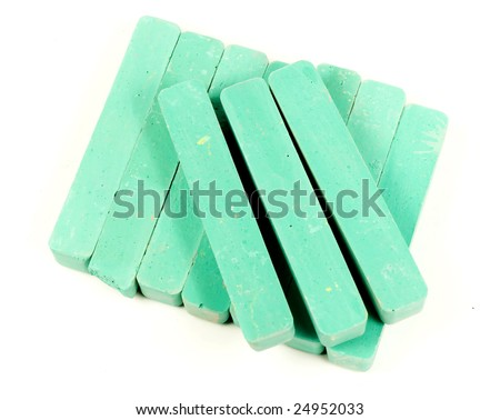 Stacked group green chalk on white background
