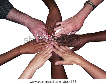 stacked hands of a diverse team of workers to showcase teamwork and unity isolated on a white background via clipping path